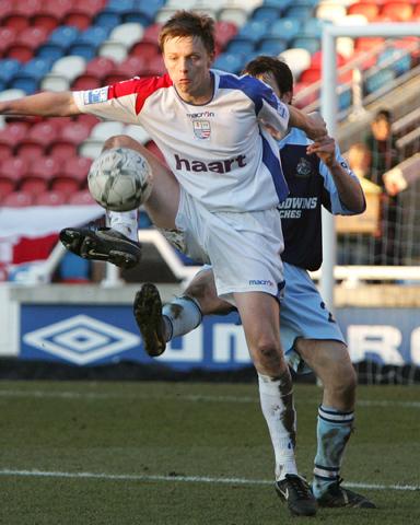 Tom Shaw controls the ball