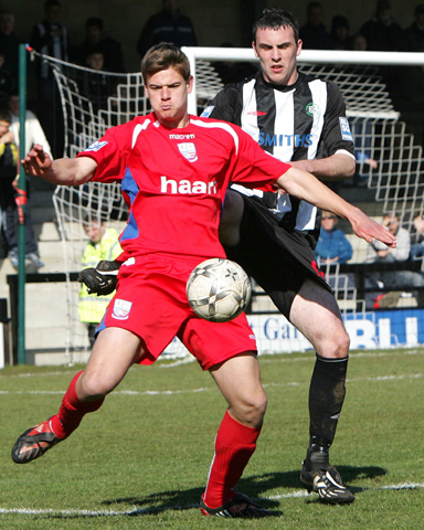 Sam Smith shields the ball from Mark Preece