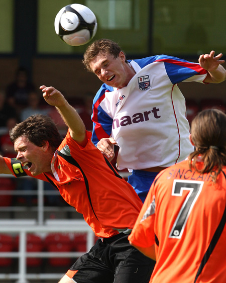 Nicky McNamara climbs above Salisbury captain Darrell Clarke