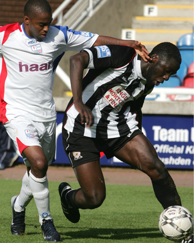 Djoumin Sangare gets away from Michael Malcolm