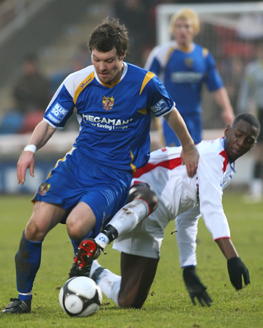 Yannick Bolasie slides in to tackle Scott Laird