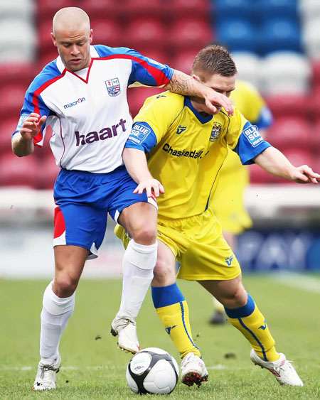 Kurt Robinson tangles with Barrow's Jason Walker