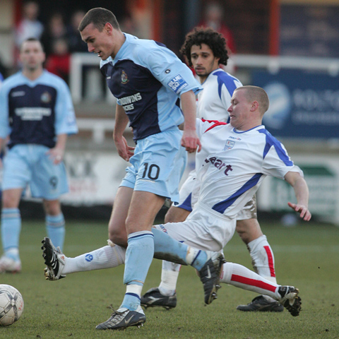 Andy Gooding slides in on Greg Young